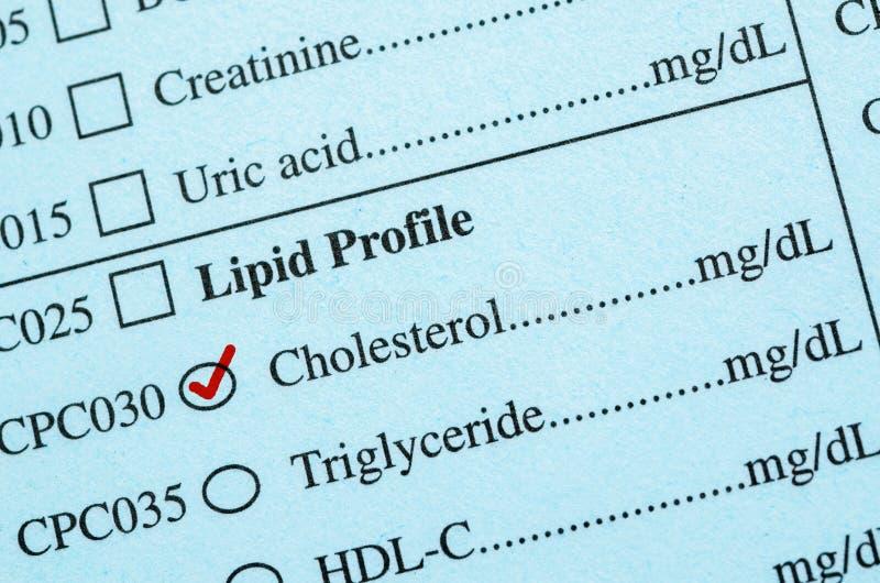 在医疗清单胆固醇的校验标志 免版税库存照片