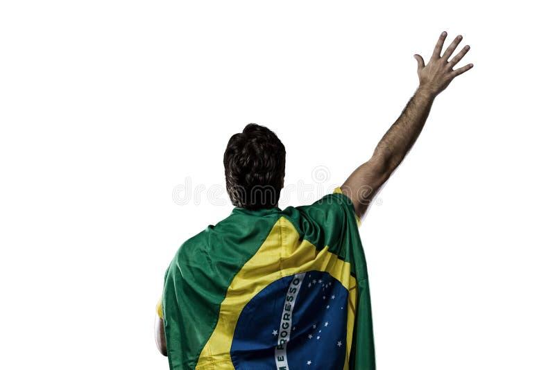 在他的一面巴西旗子  免版税库存图片