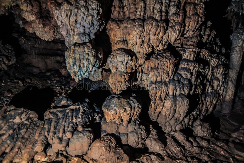 在洞的被探索的石头 库存照片
