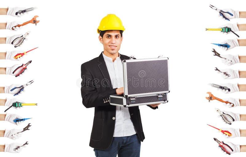 在建筑盔甲的年轻建造者 免版税库存照片