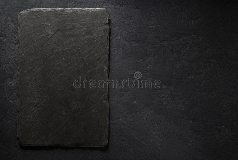 在黑背景的板岩牌 免版税库存照片