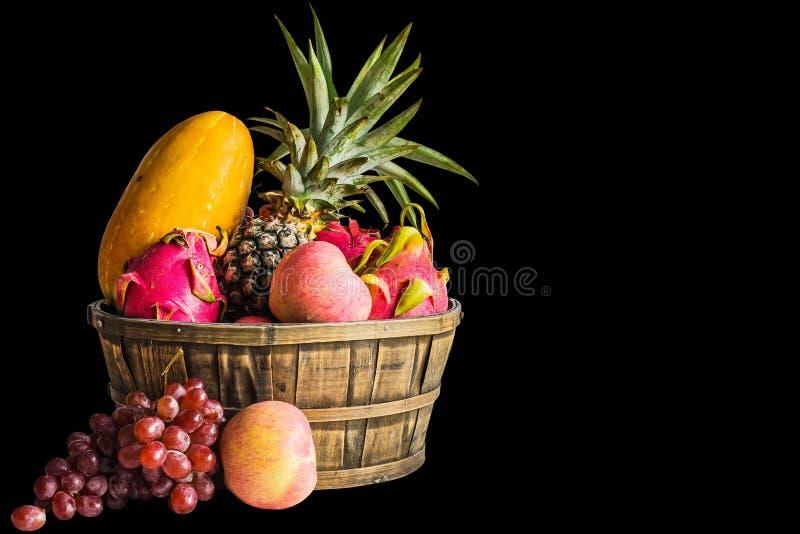 在黑背景的果子 库存图片