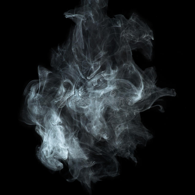 在黑背景的白色烟 库存照片
