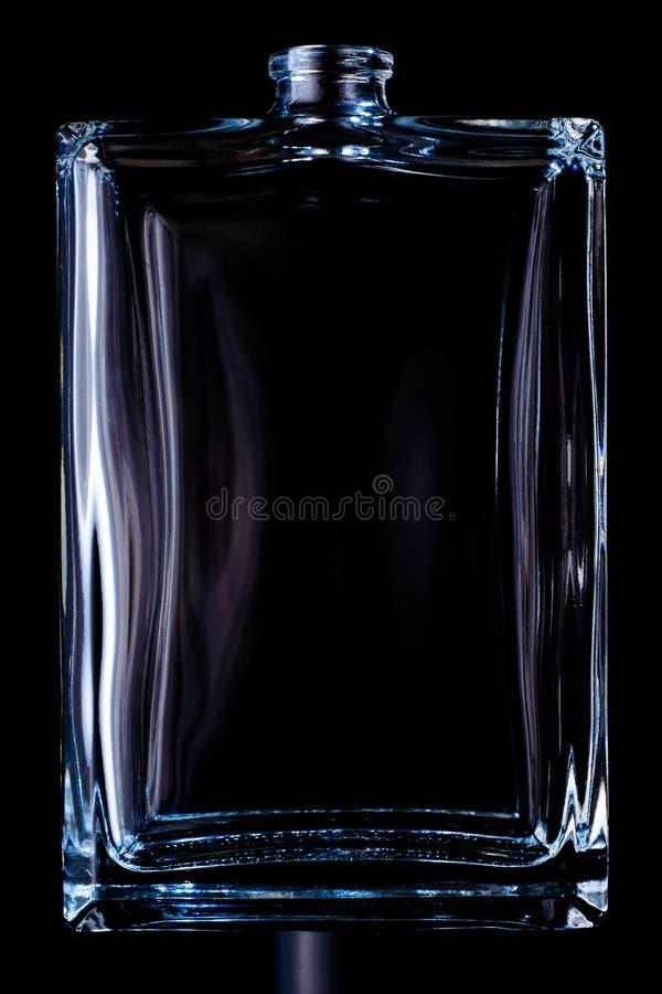在黑背景科隆香水隔绝的长方形透明瓶 免版税库存照片