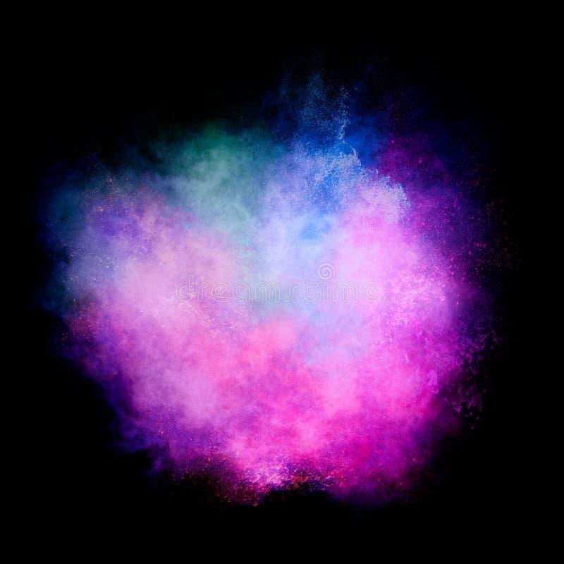 在黑背景隔绝的五颜六色的微尘爆炸 免版税图库摄影