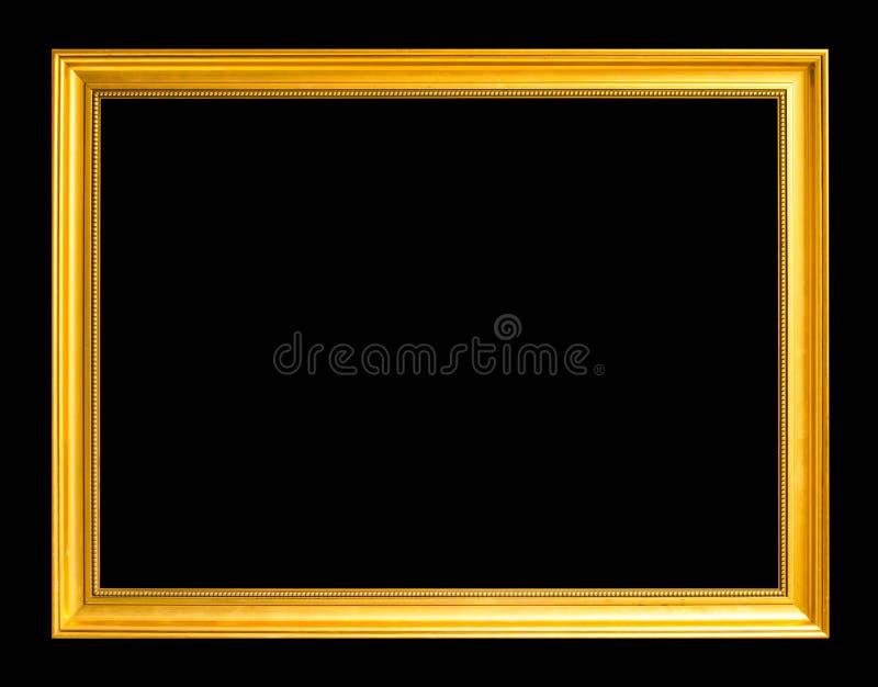 在黑背景隔绝的古色古香的金黄框架 库存照片