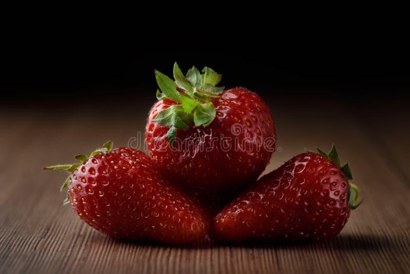 在黑背景IV的概念果子 免版税库存图片