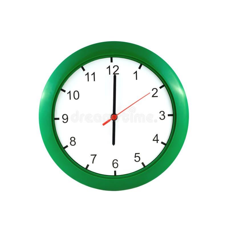 在绿色壁钟的六时 免版税图库摄影