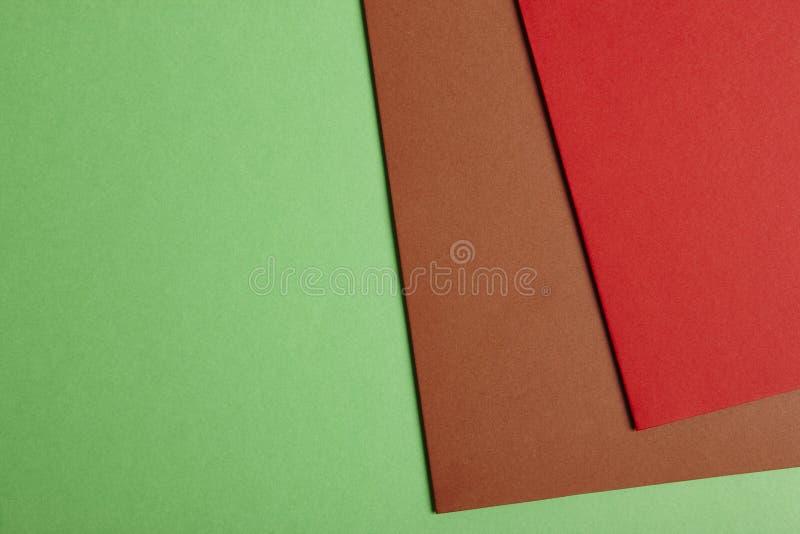 在绿色棕色红色口气的色的纸板背景 复制Spac 库存图片