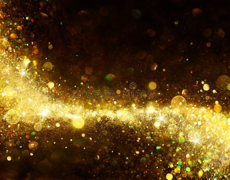 在黑色的发光的金黄足迹 免版税图库摄影