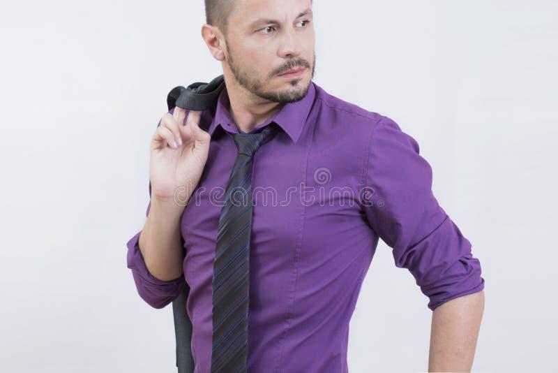 在紫色的商人 免版税图库摄影