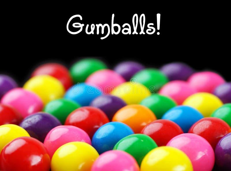 在黑色的Gumballs 免版税库存照片