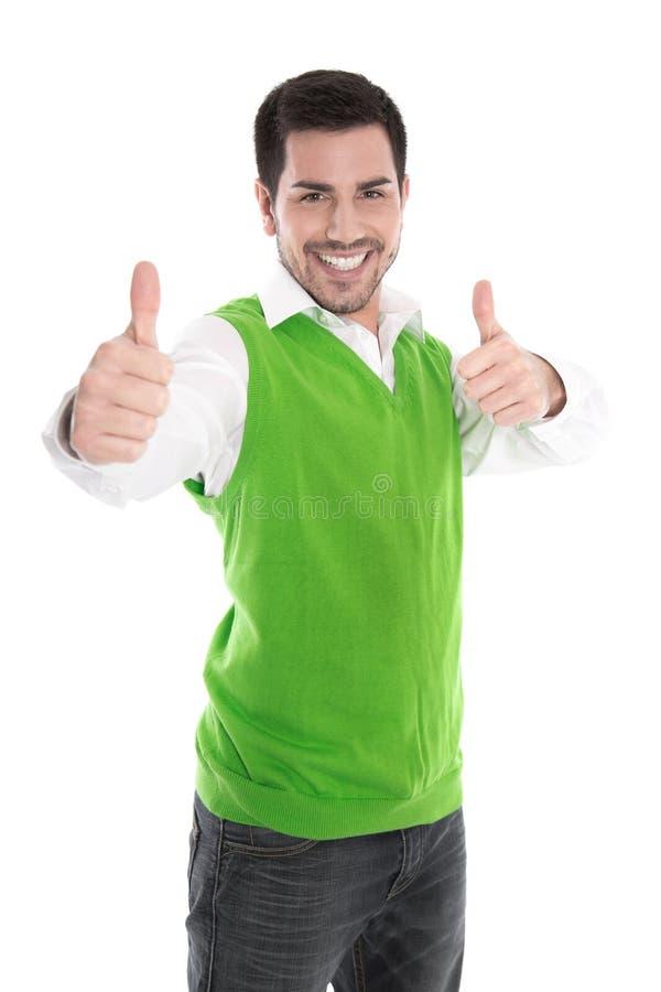 在绿色衬衣和赞许隔绝的愉快的年轻人。 免版税库存图片