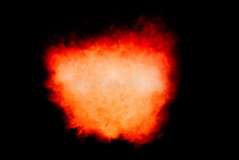在黑色隔绝的五颜六色的微尘爆炸 库存图片