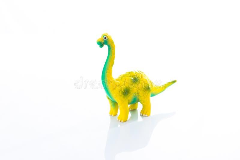 在黑色隔绝的恐龙玩具 免版税库存照片