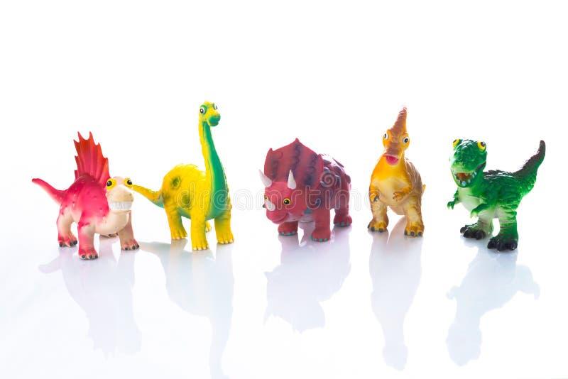 在黑色隔绝的恐龙玩具 免版税库存图片