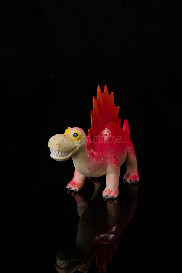 在黑色隔绝的恐龙玩具 库存图片