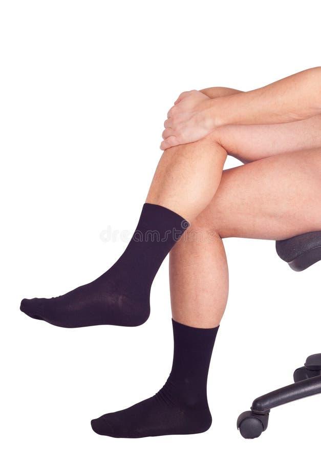 在黑袜子的男性腿。隔绝在白色 免版税图库摄影