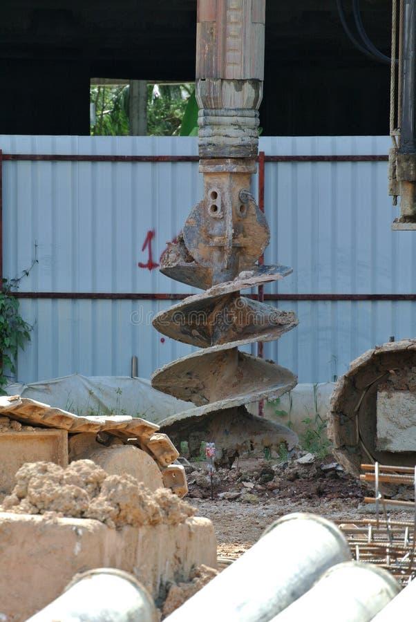 在建造场所使堆船具木钻不耐烦 图库摄影