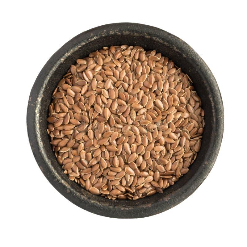 在黑铁碗的未加工的干燥亚麻籽或油麻堆 图库摄影