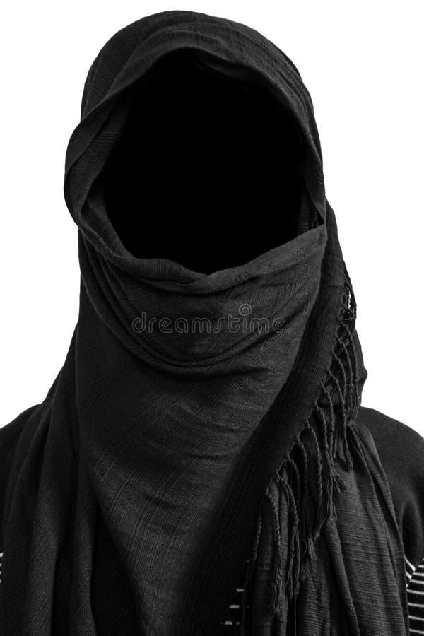 在黑面纱下的匿名的人,隔绝在白色背景 免版税库存照片