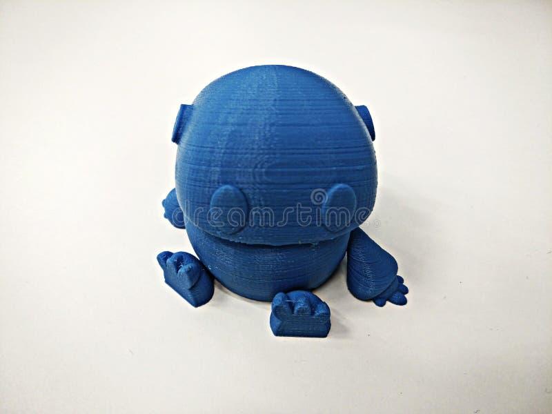 在3d打印的蓝色机器人模型 免版税库存照片