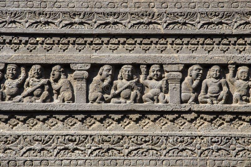 在Aurangabad,印度晃动雕刻Ajanta洞纹理背景  图库摄影