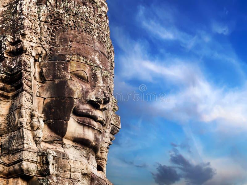 在Bayon寺庙吴哥城的佛教石面孔 免版税图库摄影