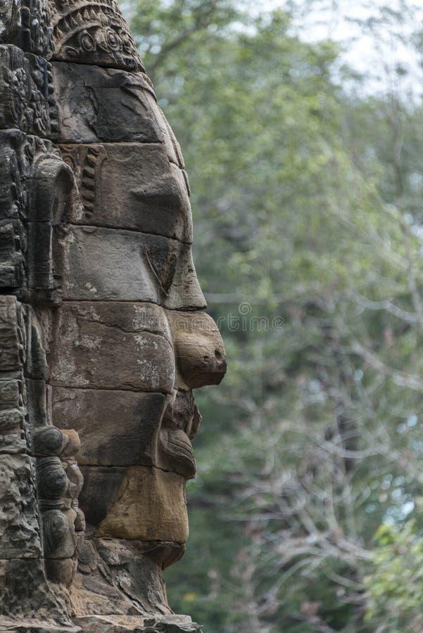 在Bayon寺庙,吴哥窟,柬埔寨的石面孔 库存照片