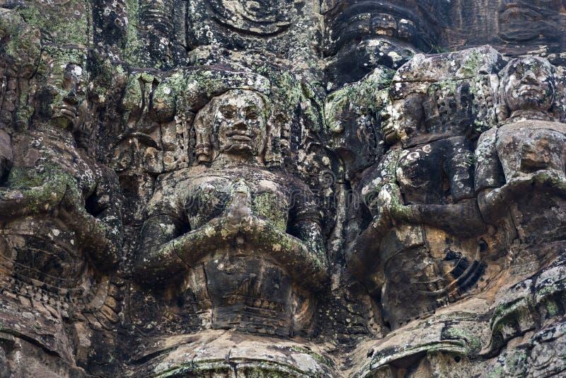 在Bayon寺庙,吴哥,柬埔寨的古老石雕塑 库存照片