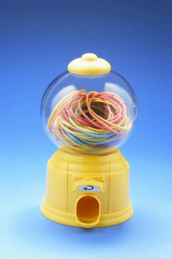 在Bubblegum机器的Rubberbands 库存图片