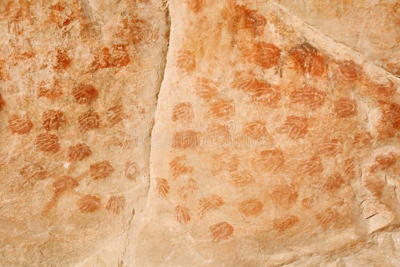 在Elands的丛林居民绘画使- palmprints陷下 库存图片