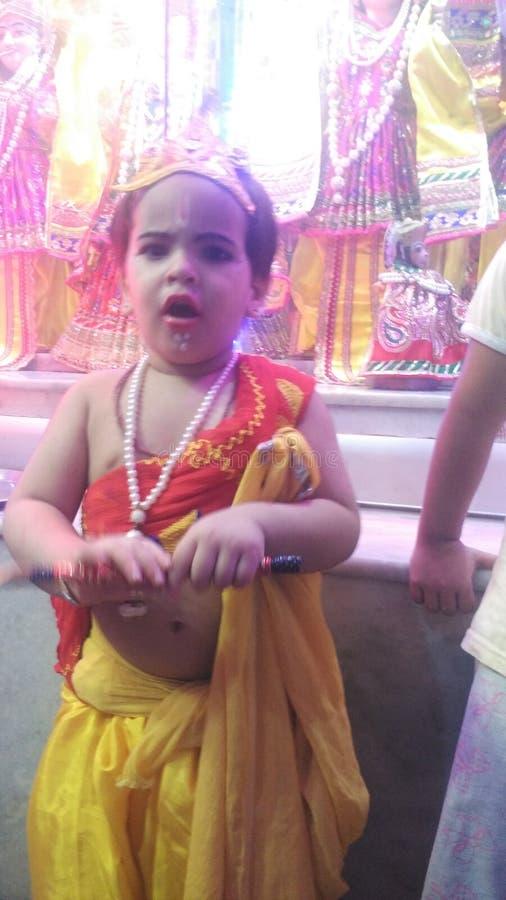 在Janmashtimi节日的小的克里希纳照片  库存图片