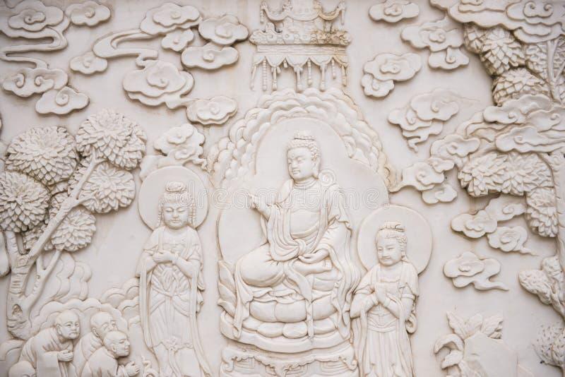 在jing的`的小菩萨大理石雕刻的墙壁寺庙 免版税库存图片