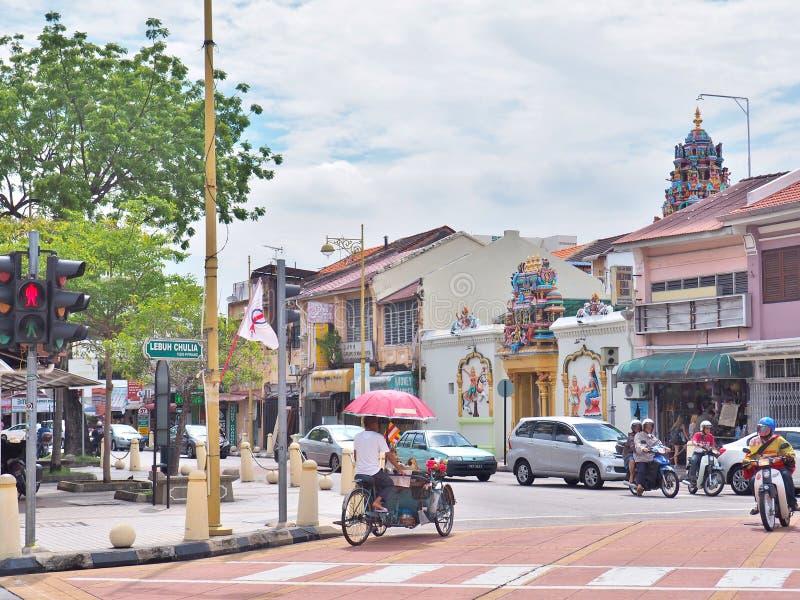 在Lebuh Chulia的连接点的Trishaw与Jalan Masjid Kapitan前Keling彼特街的在乔治市 库存图片