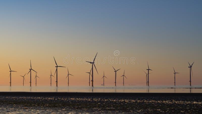 在Redcar windfarm的日落 免版税库存图片