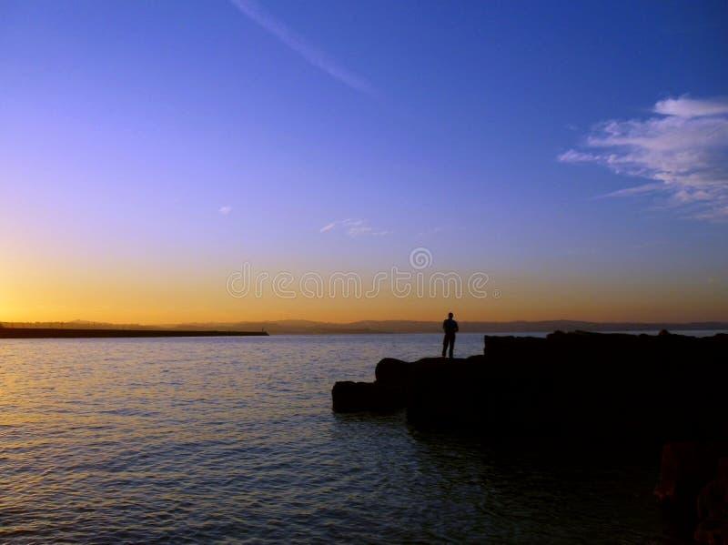 在Shoalstone, Brixham,德文郡的日落剪影 库存图片
