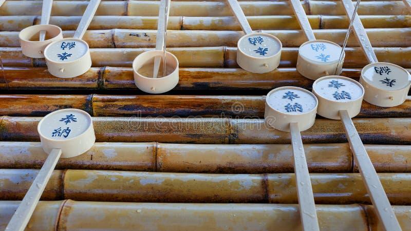 在Todaiji寺庙的水浸染工 免版税库存照片