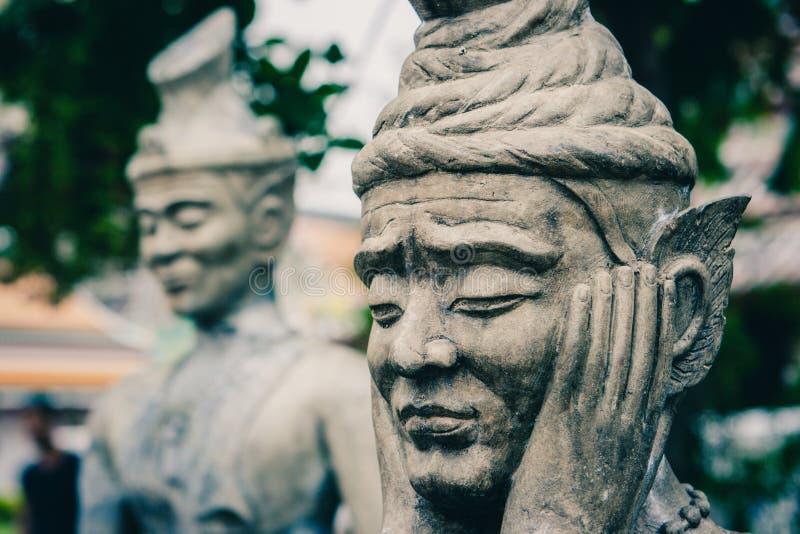 在Wat Pho寺庙的中国石雕象,曼谷,泰国 免版税库存照片