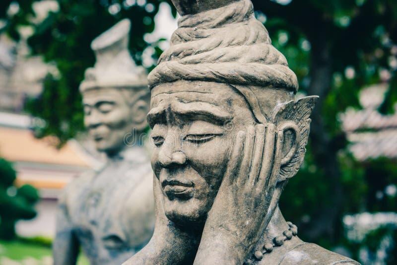 在Wat Pho寺庙的中国石雕象,曼谷,泰国 免版税库存图片