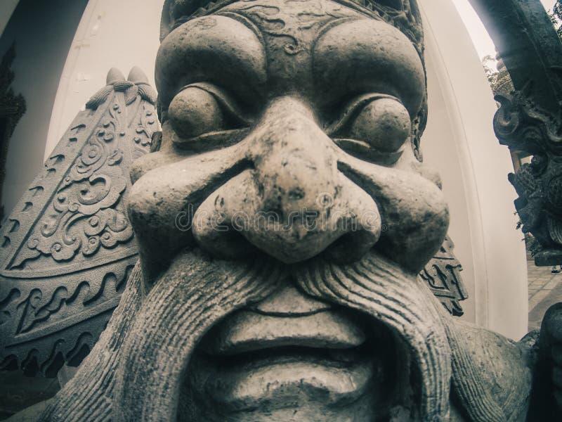在Wat Pho寺庙的中国雕象在曼谷,泰国 图库摄影