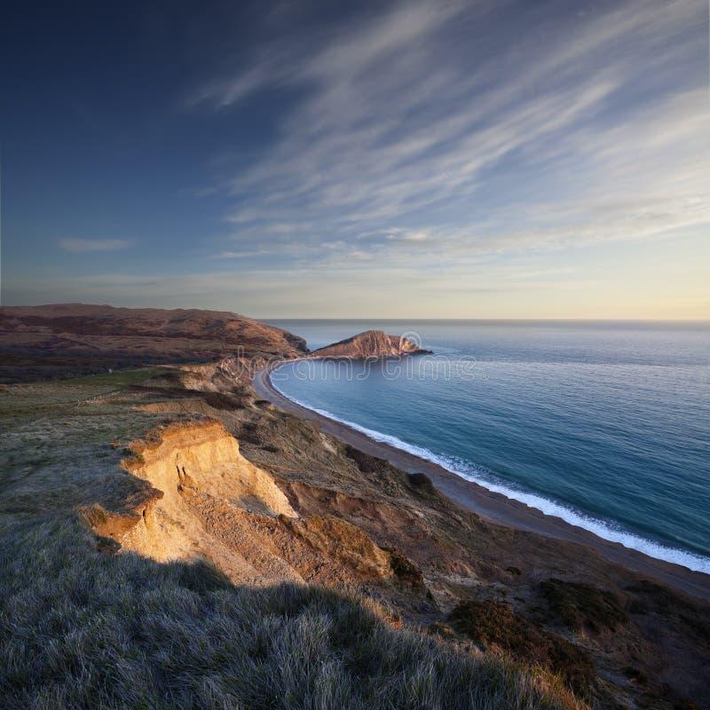 在Worbarrow海湾的日落在多西特的侏罗纪海岸 库存照片