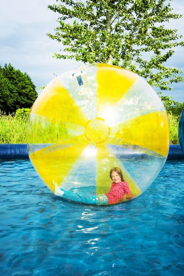 在Zorb球形里面的女孩 免版税库存照片