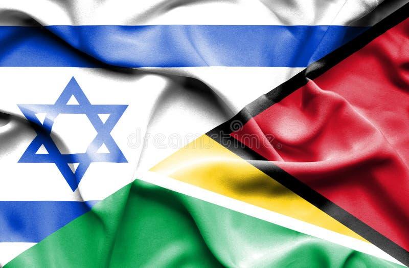 圭亚那和以色列的挥动的旗子 库存例证