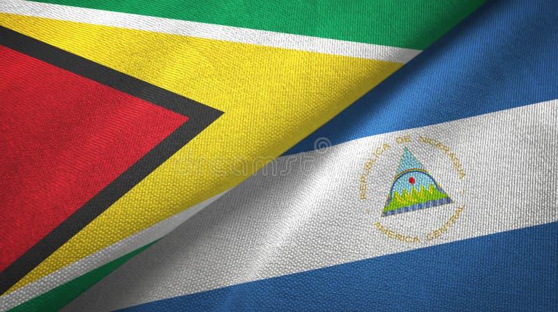圭亚那和尼加拉瓜两旗子纺织品布料,织品纹理 皇族释放例证