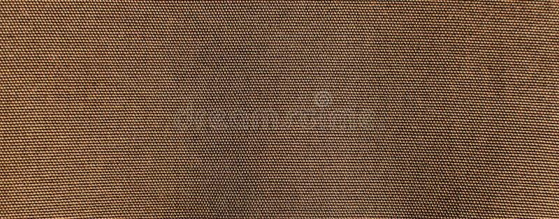 织地不很细背景或墙纸从卡其色的颜色粗砺的织品  免版税库存照片
