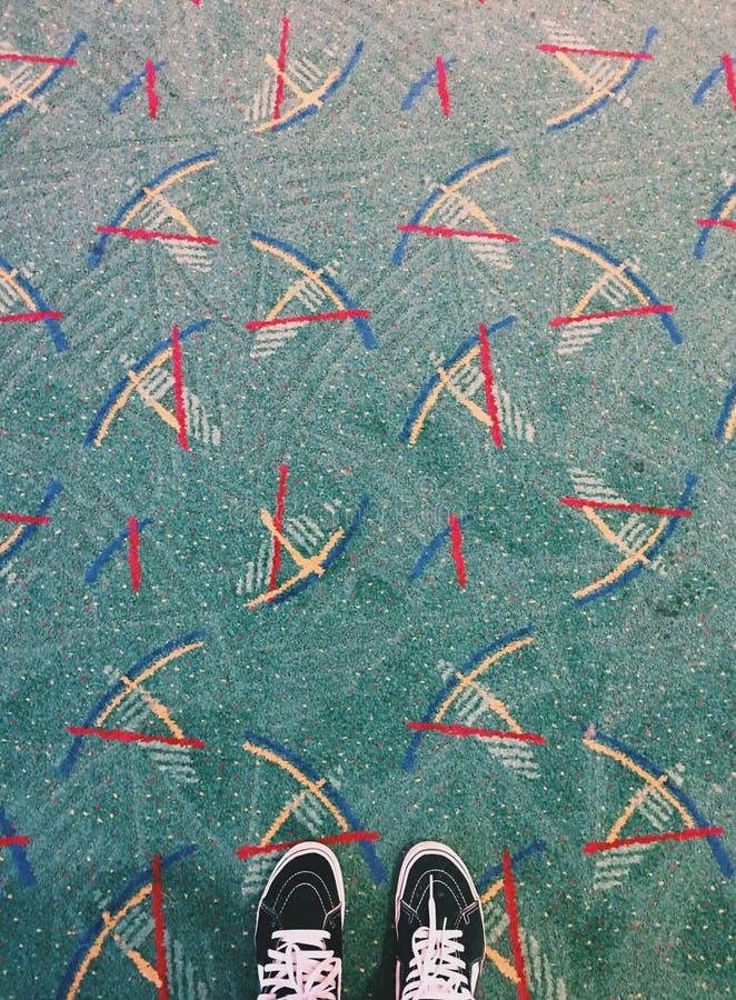 地毯和运动鞋 库存图片