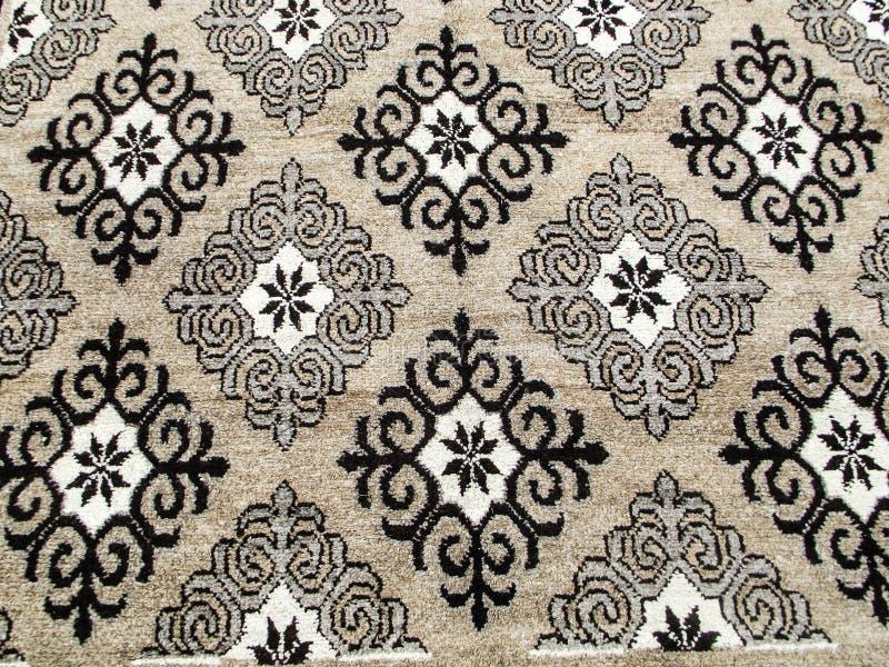 地毯手工制造羊毛 在地毯绣的全国样式 免版税库存照片