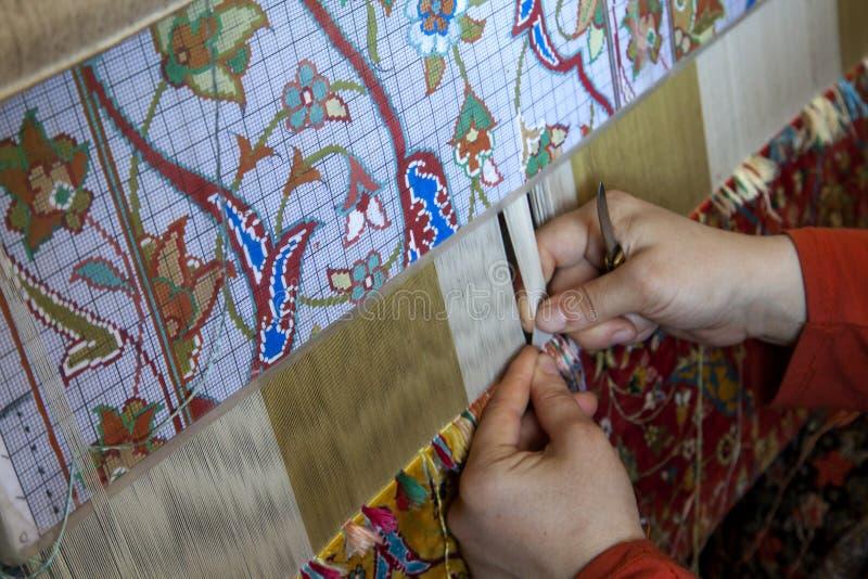 地毯的手工生产 免版税库存照片