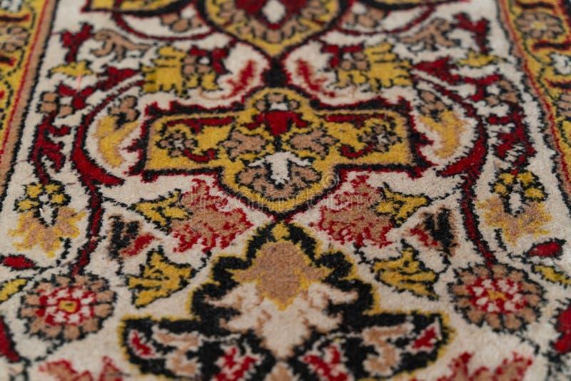 地毯的纹理有一个抽象样式特写镜头的作为背景 库存图片